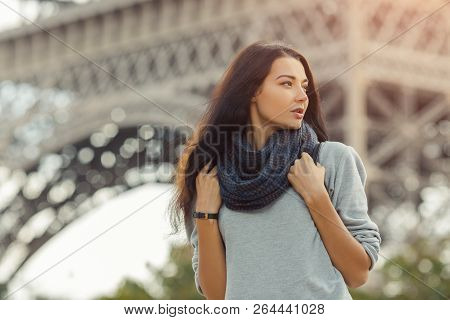 Paris Eiffel Tower tourist woman with backpack walking of the Eiffel tower, Paris, Portrait of travel tourist girl on vacation walking calm outdoors. Gorgeous mixed race Asian Caucasian female enjoying traveling outdoors during holidays in Europe. stock photo