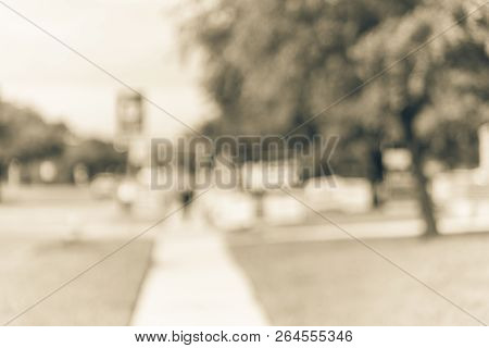 Vintage tone blurred row of yard signs at residential street for primary election day in Dallas county, Texas, US. Signs greeting early voters, political party posters for the midterm election concept stock photo