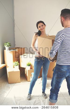 Happy young couple unpacking or packing boxes and moving into a new home. young couple stock photo