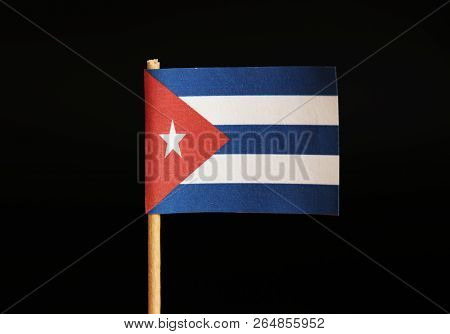 A national flag of Cuba on toothpick and on black background. Cuba is famous for criminality and import and export drugs and cigars. White stars in red field. stock photo