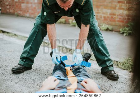 Paramedic team rescuing an injured patient stock photo