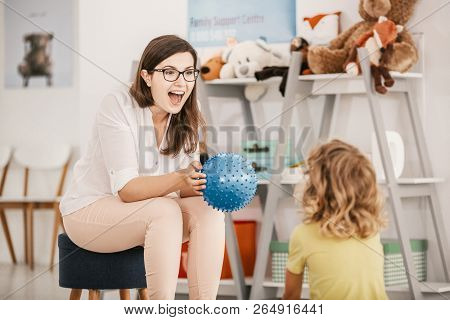 A young child development therapist working with a child to overcome his problems stock photo