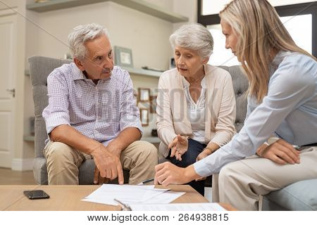 Business agent planning with a retired couple their future investment opportunities. Financial advis