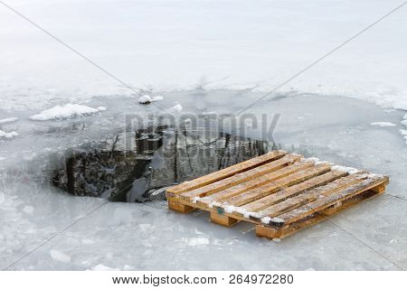 Wooden pallet Euro pallet next to the swimming hole Epiphany walruses stock photo