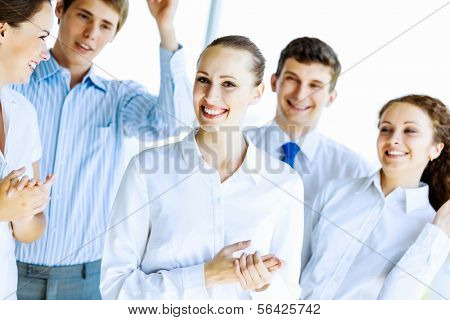 Image of young businesspeople congratulating colleague. Success concept stock photo