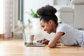 African American Woman Using A Laptop In Her Living Room - Black People