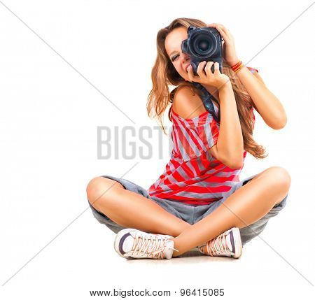 Photographer. Beauty Teenage Girl taking photo, sitting and Smiling. Beautiful Teen Girl with profes