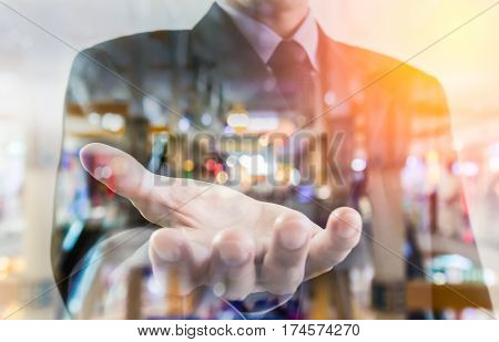 Business Man. Business put his hand forward and business city. Business working and business people concept. Business city background. Business man over sunny office and business people background, business content, business background.