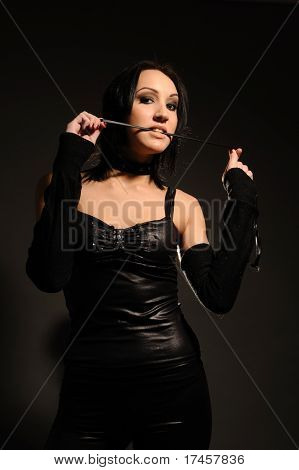 attractive girl in a collar with leash on her neck, sexual role games. stock photo