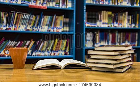 Books concept. Open book, cup of tea and more books on table in Library, Reading And Science, School And University, School Library, Bookstore, Books On Bookshelves, Stack Of Old Books, Stacked Books
