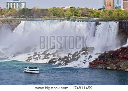 Beautiful photo of a ship near amazing Niagara waterfall stock photo