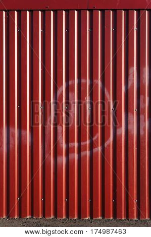 Corrugated metal sheet. Red textured background. stock photo
