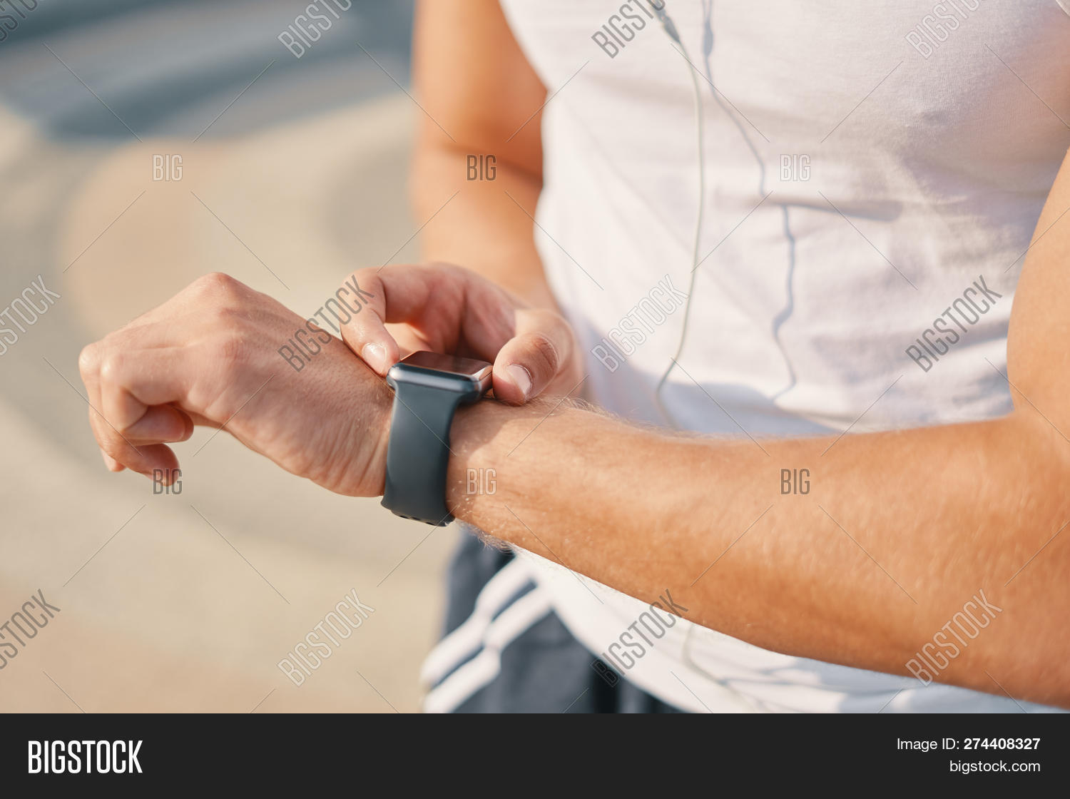 Close-up,Person,Young,accessory,app,application,beets,checking,computer,connection,consumerism,device,digital,display,earphones,exercise,fitness,gadget,gestures,hand,heart,intelligence,internet,making,male,man,measuring,puls,runner,smart,smartwatch,sport,t-shirt,technology,touch,unrecognizable,using,watch,wearable,white