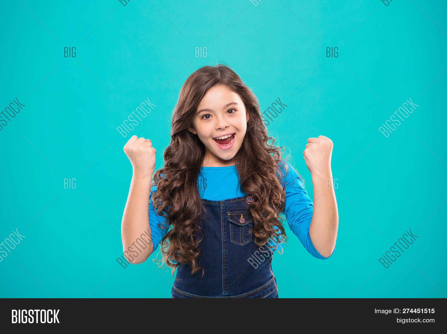 Kid Cheerful Celebrate Victory. Girl Cute Child Long Curly Hair Happy Smiling. Child Psychology And