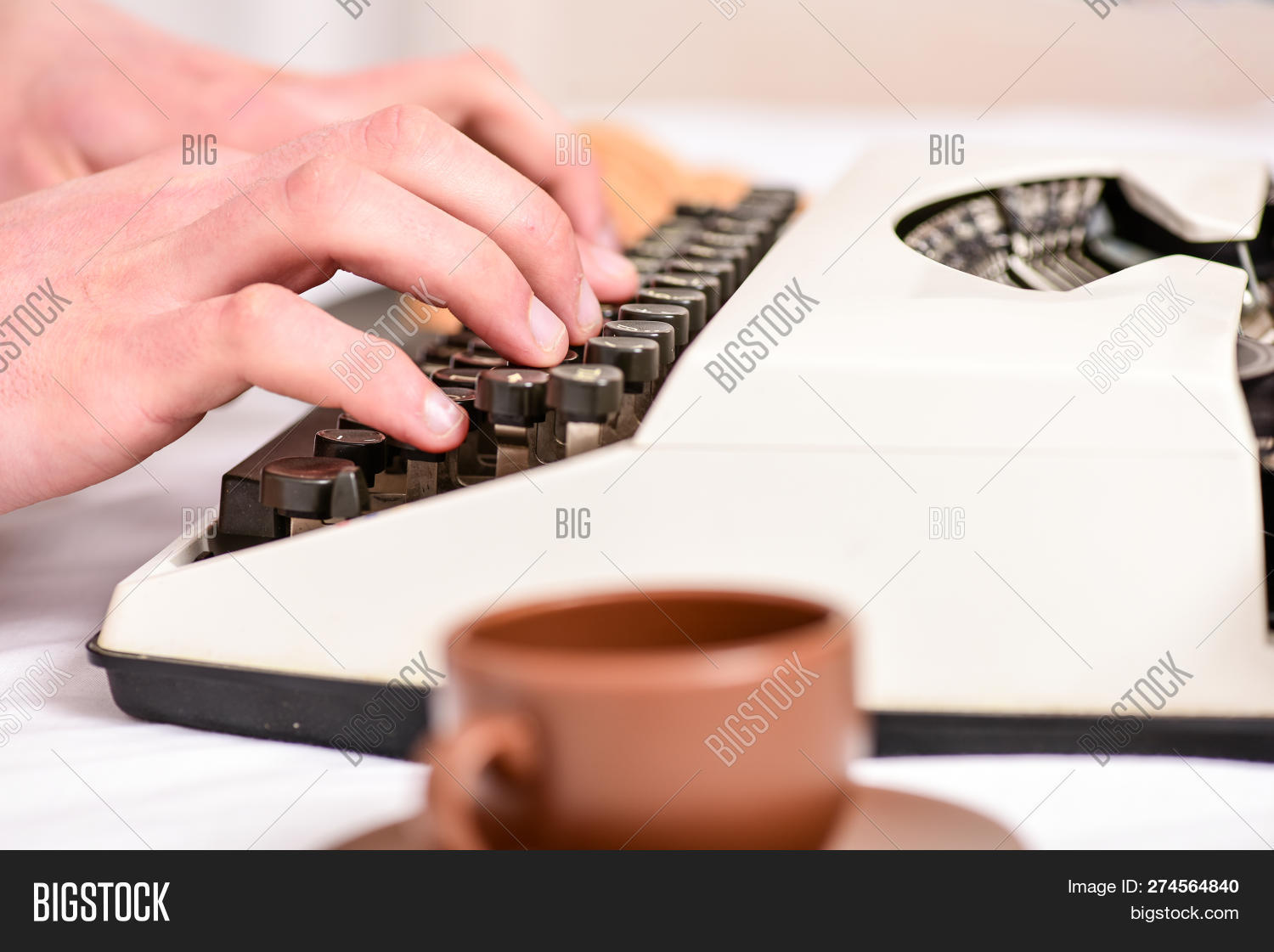 alphabet,author,button,classic,close,concept,creative,document,editor,equipment,finger,hand,journalist,key,keyboard,letter,letterpress,machine,male,mechanical,message,note,novel,old,outdated,press,print,qwerty,report,retro,routine,story,text,type,typewriter,typing,typography,up,using,vintage,white,work,write,writer,writing