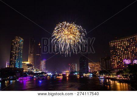 Firework colorful on night city view background for celebration festival. stock photo