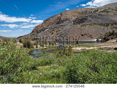 20 Lakes Basin backpacking and wilderness hiking the California Eastern Sierra Nevada Mountains in the summer. stock photo