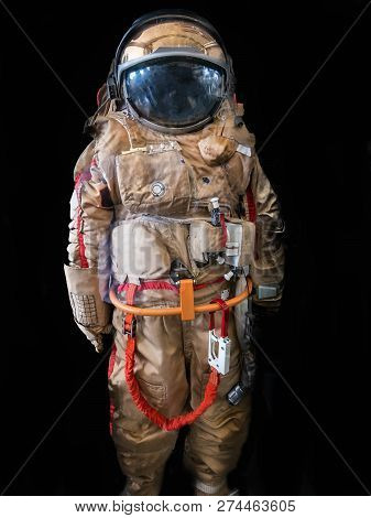 Astronaut or spaceman or cosmonaut on dark background as sci-fi or fantastic explore background for design, vertical image stock photo