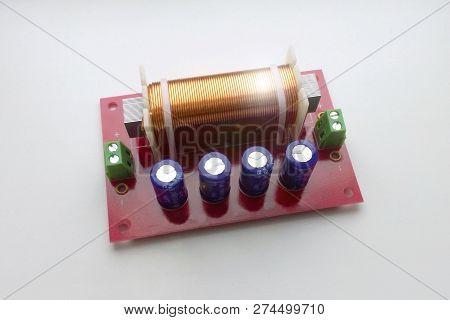 Acoustic crossover low-pass and high-pass filter, musical equipment for hi-fi quality acoustics assembly stock photo