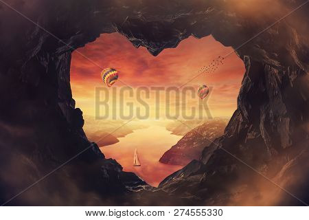 Scenery view through a heart shaped cave exit to a beautiful sunset over the valley, a boat floating on the calm river and hot air balloons in the sky. Meditative calm landscape, paradise silence. stock photo