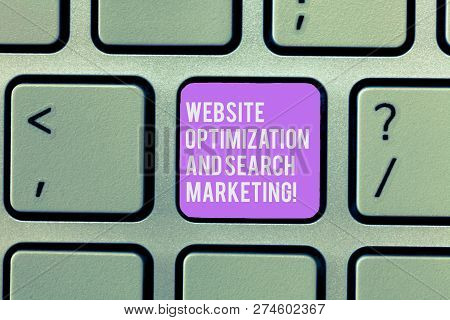 Text sign showing Website Optimization And Search Marketing. Conceptual photo Search engine optimization Keyboard key Intention to create computer message, pressing keypad idea. stock photo