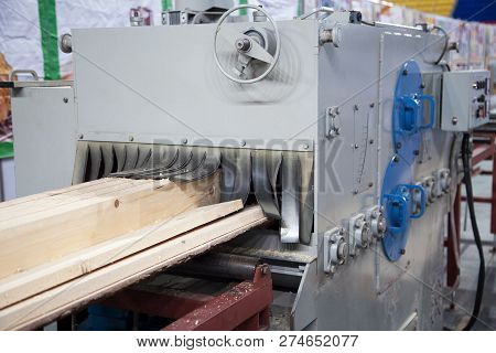 Big industrial sawmill cutting wood into boards. Woodworking facility producing lumber stock photo