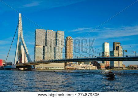 Panorama of Rotterdam cityscape with Erasmus bridge over Nieuwe Maas river on sunset. Netherlands stock photo