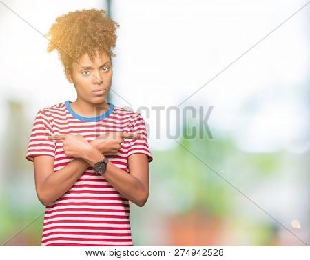 Beautiful young african american woman over isolated background Pointing to both sides with fingers, different direction disagree stock photo