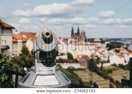 Coin operated binoculars on the viewing platform in Prague, in summer, the blurred city background. stock photo