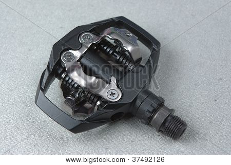 Bicycle clipless pedal on the grey background stock photo