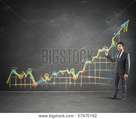Businessman showing prositive statistics of the Company stock photo