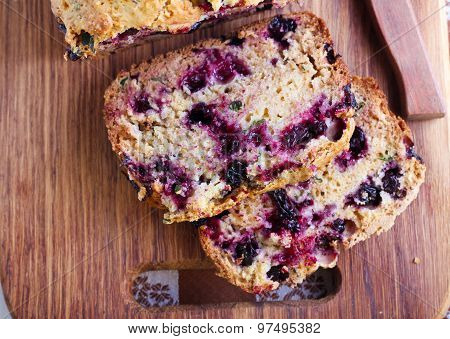 Berry mint and spelt flour teacake sliced on board selective focus stock photo