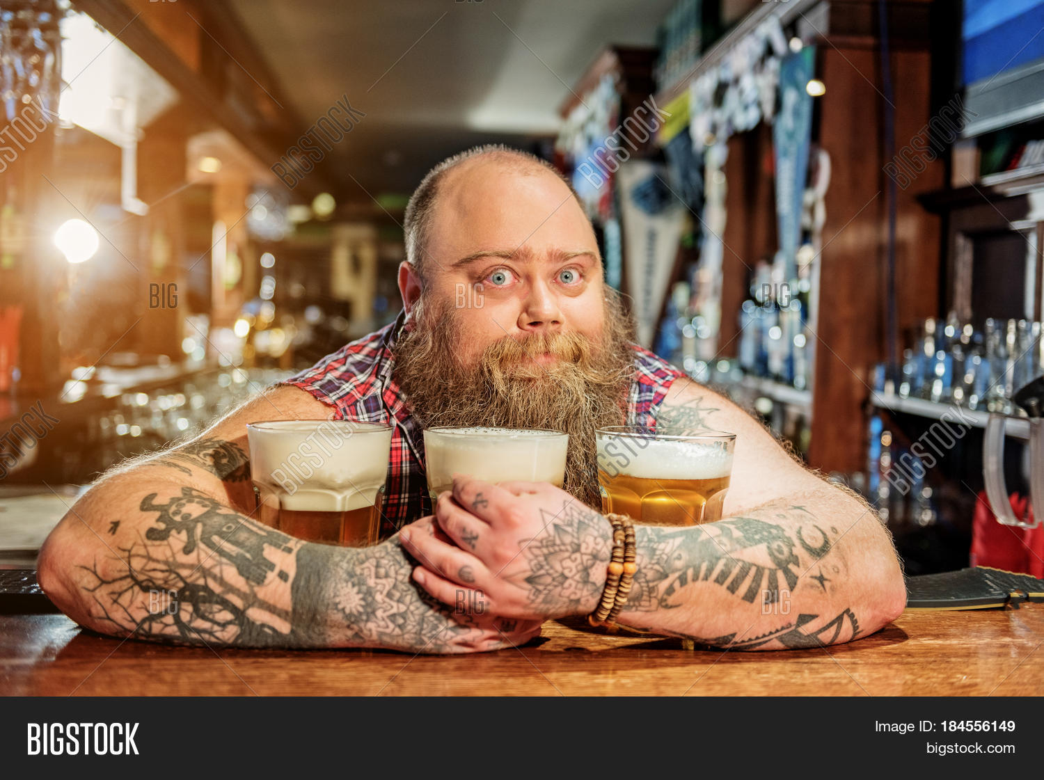adult,alcohol,ale,alehouse,bar,barman,beard,beer,beverage,boozer,brew,bubble,can,container,counter,cup,dramshop,drink,equipment,fat,faucet,foamy,frothy,glass,hand,hold,hug,indoor,keep,keg,light,liquid,male,man,mug,pint,portrait,pour,pub,pump,refreshment,service,staff,stout,tap,taste,thirsty,tool,waiter,work