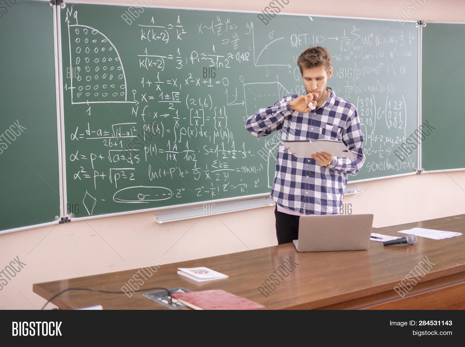 Young Professor Proving Theorem On A Blackboard