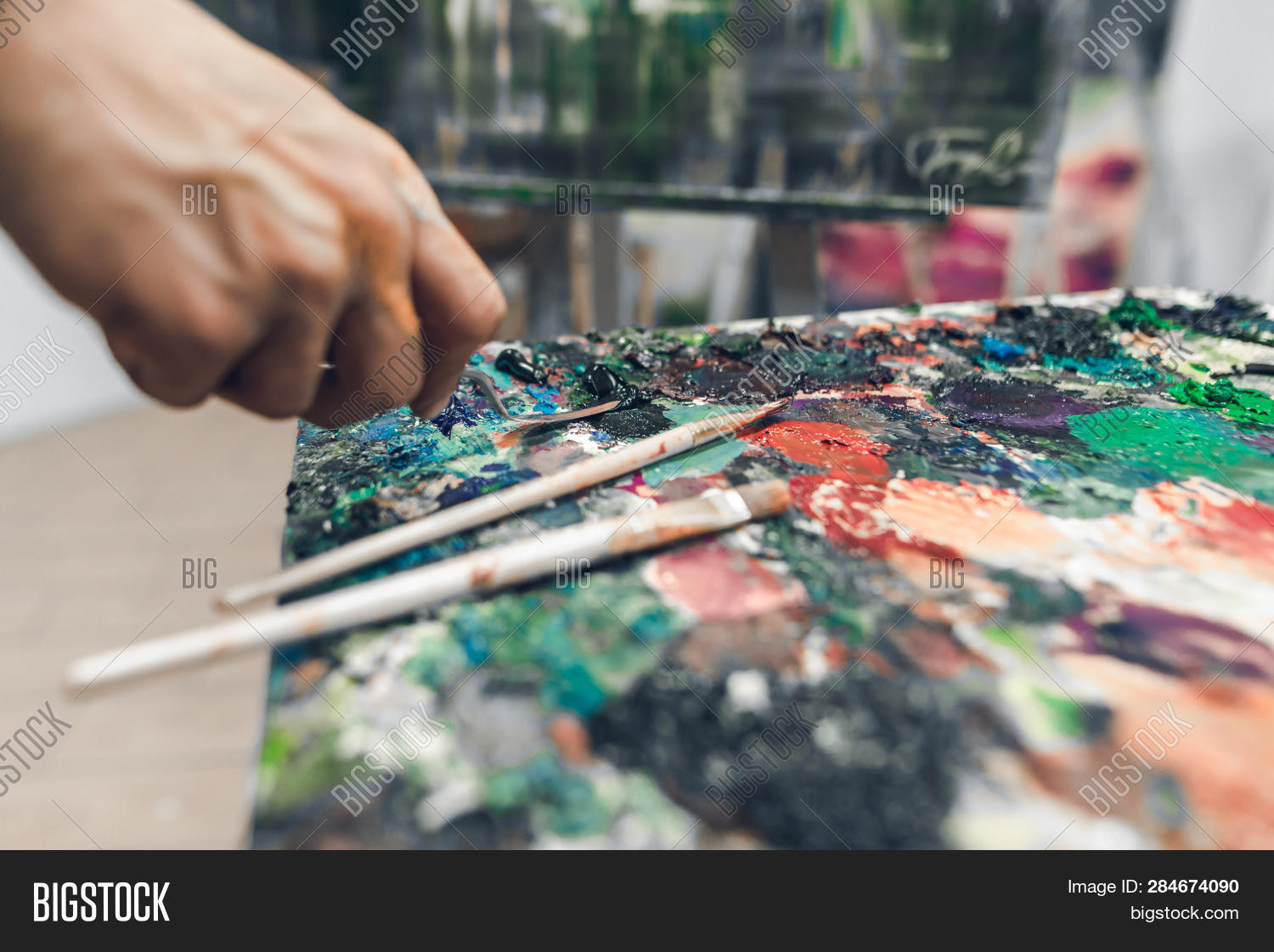 abstraction,arm,art,artist,artistic,artwork,blend,blobs,brash,canvas,close-up,closeup,color,colorful,combine,courageous,crafts,creation,creative,creativity,design,detail,draw,drawing,easel,equipment,female,fingers,hand,hold,human,knife,liquid,male,man,mess,mix,mixing,oil,paint,paintbrush,painter,palette,pallet,panel,stain,study,tools
