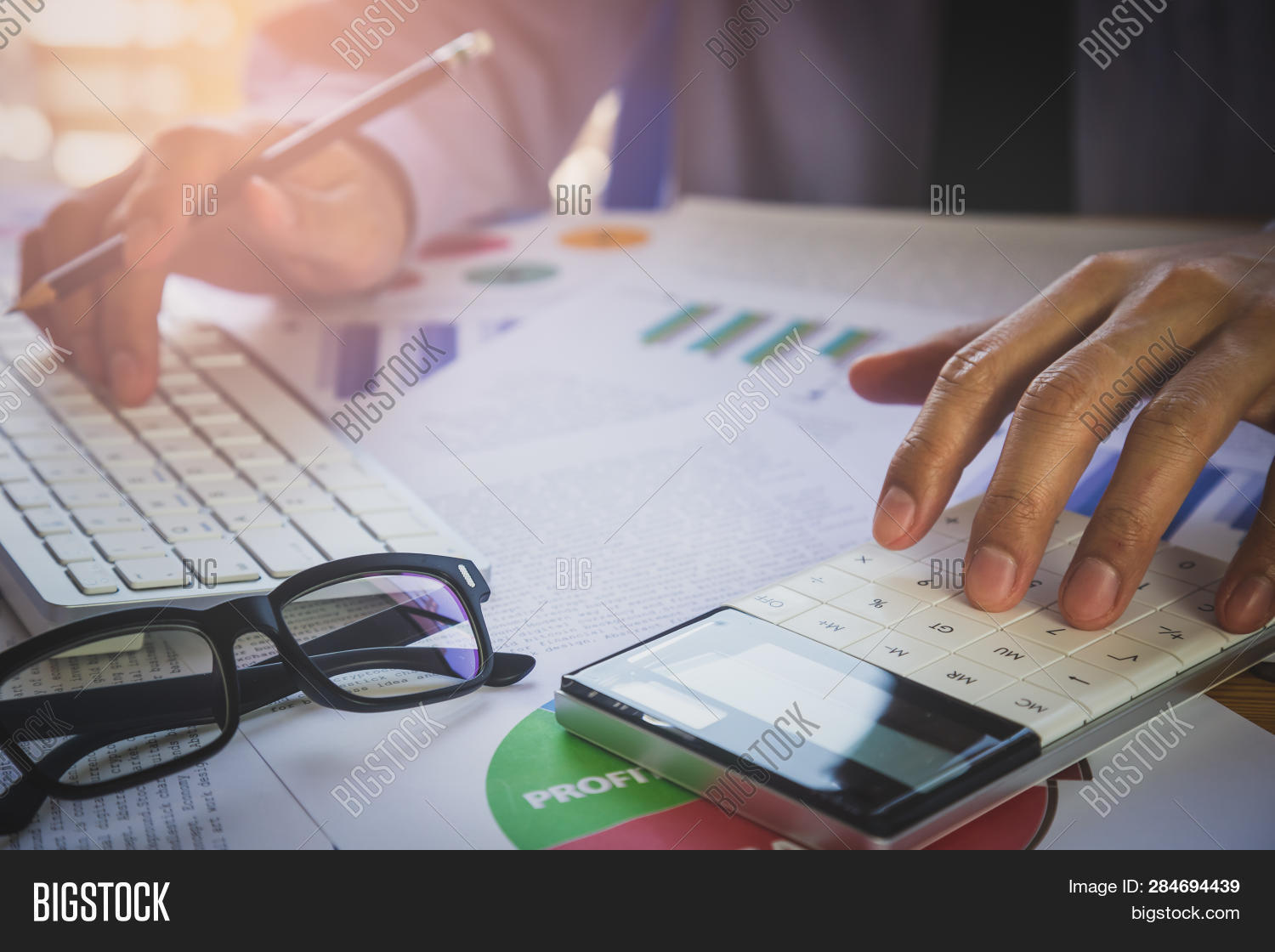 Businessman Or Accountant Working On Calculator To Calculate Business Data Concept. Accounting,inves