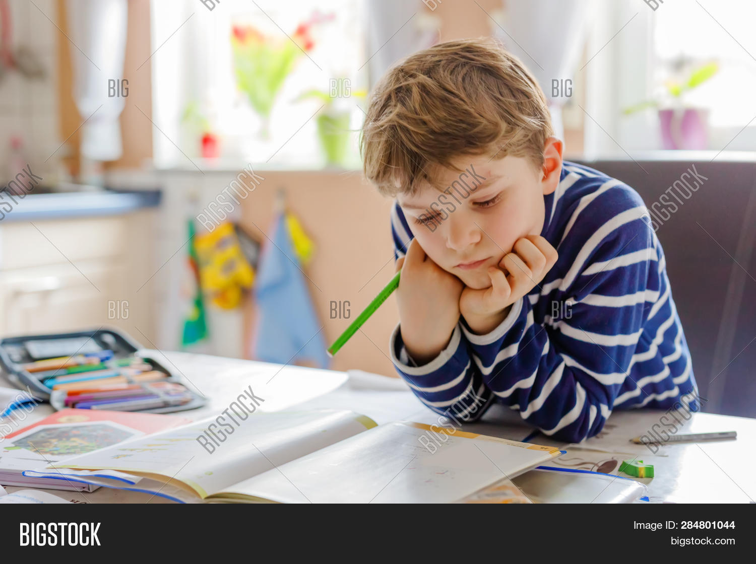 book,boy,caucasian,cheerful,child,childhood,counting,curious,cute,desk,drawing,education,educational,elementary,face,handsome,happy,home,homework,horizontal,indoor,kid,knowledge,learn,lifestyle,little,male,mathematics,one,pencil,people,portrait,positive,preschool,preschooler,primary,pupil,room,school,schoolboy,schoolchild,schoolkid,smiling,student,studying,white,writing,young,youth