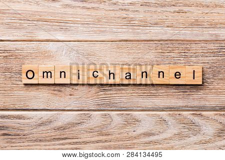 OMNICHANNEL word written on wood block. OMNICHANNEL text on wooden table for your desing, concept stock photo