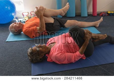 High angle view of determined senior couple exercising gym excercie in fitness studio stock photo
