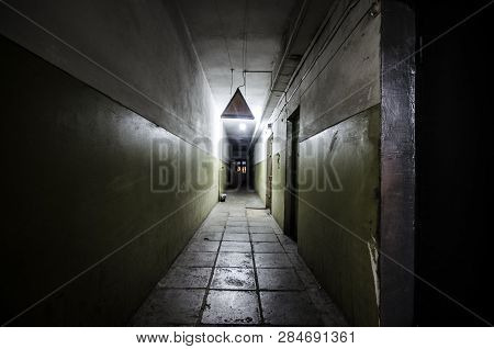 Dark corridor. Mystical interior of dark empty corridor, tunnel in an abandoned house. Dark mysterious corridor. The interior of an abandoned house, road to hell. An old abandoned building stock photo