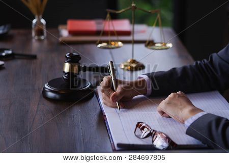 Professional female lawyers working at the law firms. Judge gavel. Legal law, lawyer, advice and justice concept.Concepts of law. stock photo