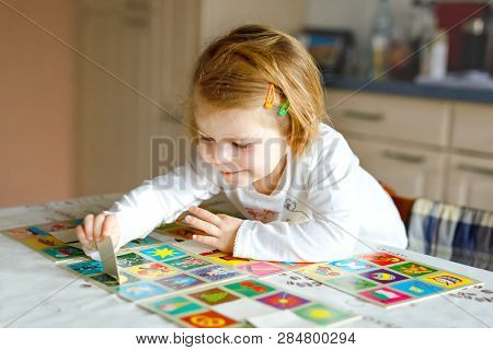 Adorable Cute Toddler Girl Playing Picture Card Game At Home Or Nursery. Happy Healthy Child Trainin