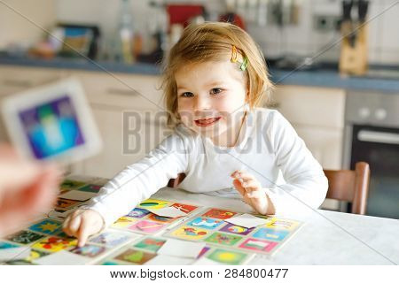 Adorable Cute Toddler Girl Playing Picture Card Game With Mother Or Father. Happy Healthy Child Trai