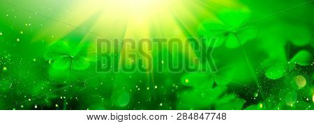 St. Patrick's Day green background decorated with shamrock leaves. Patrick Day pub party celebrating. Abstract Border art design Magic nature backdrop. Widescreen clover art design with copy space stock photo