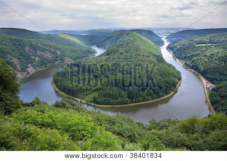 View of a river Saar with Saarschleife by city Orscholz Saarland / Germany summer panoramic stock photo