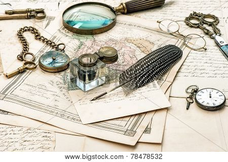 old letters and maps vintage ink pen. ephemera and antique accessories. retro style toned picture stock photo
