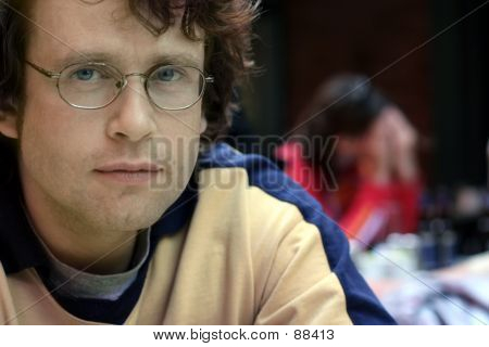 Young man and a crying woman on the background stock photo