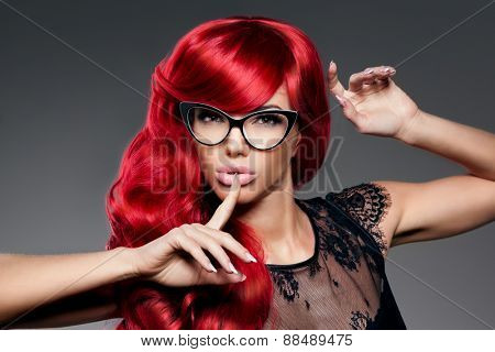 Luxury fashion trendy  young  woman with red curled hair in glasses. Optics. Girl with beauty hairst