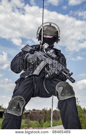 Special forces operator during assault rappeling with weapons stock photo