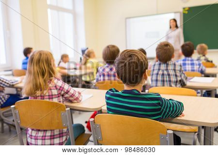 training, grade school, learning and individuals idea - gathering of school children sitting and lis